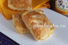 Пирожки с рисом и яйцом из слоеного теста